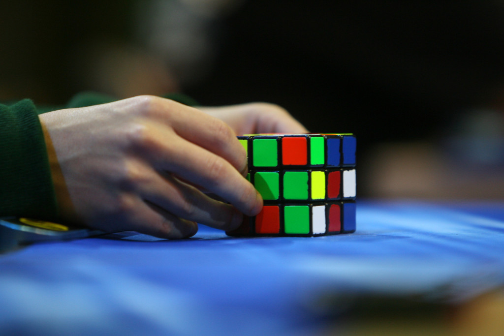 A competitor tries to solve the Rubik cube on the final day of the 2010 Rubik's Cube German Championships in the 3x3x3 cube 'Classical category' in the western German city of Bottrop on September 12, 2010. AFP PHOTO PATRIK STOLLARZ (Photo credit should read PATRIK STOLLARZ/AFP/Getty Images)